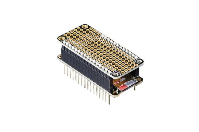 A product image for FeatherWing Proto – Scheda di prototipazione