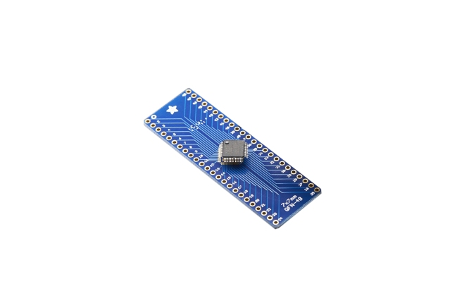 A product image for Adafruit SMT Breakout PCB for 48-QFN or 48-TQFP – 3 Pack